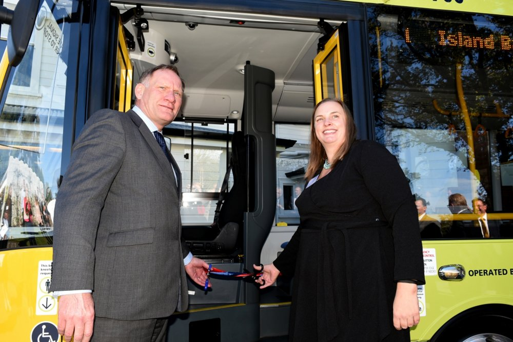 Graham Belgum, Optare President cuts the ribbon to launch the bus with Acting British High Commissioner, Helen Smith