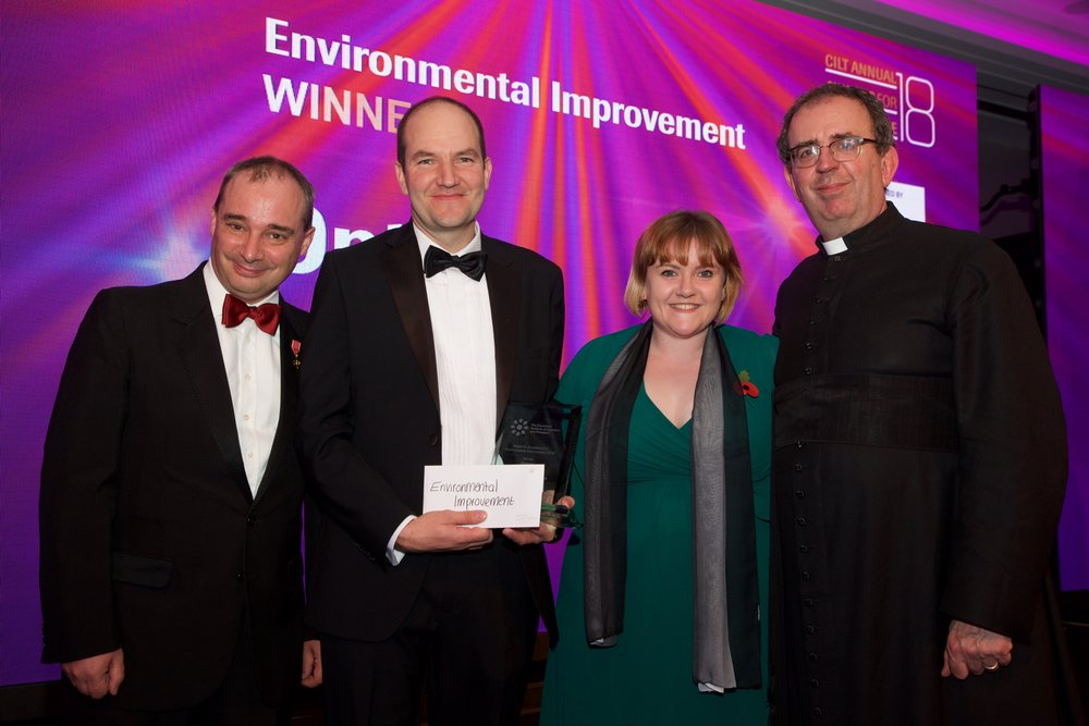 Left to right: Richard Wilding, Chairman, CILT(UK), Adam Rowlands, Lead Electrical Engineer, Emma Ross, Warehouse Manager GB & Ireland (who presented the award on behalf of the award sponsor, The Environment Network) and the Reverend Richard Coles.