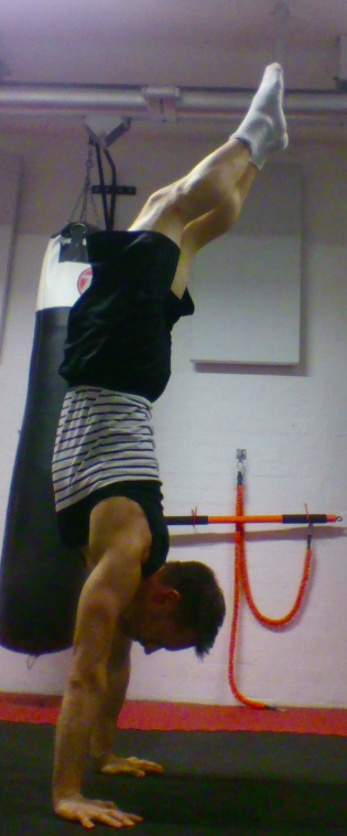 The head out position again makes it necessary for a counter-balance that prevents an attractive, straight handstand