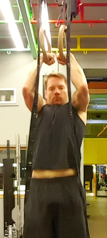 Hand position is key in the muscle-up. In the initial pull-phase knuckles should be facing each other