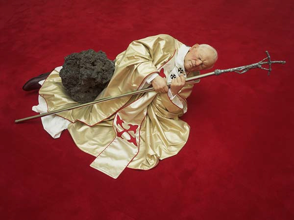 "Maurizio Cattelan's "" Pope struck by a meteorite"" sculpture sold for 3 million . I wonder if it's in the basement of the vatican ? and no…I will not kneel down in BJ position to take that stale wafer.- lady kier"
