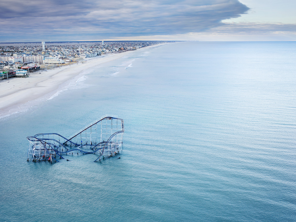 Photographer Stephen Wilkes captured this eerie vision of Seaside Heights, NJ after hurricane sandy devastated the  area .The Star Jet roller coaster at Casino Pier—normally a symbol of fun and frivolity—sits in the Atlantic Ocean.     This photograph is part of the   Art for Sandy Relief  project released in collaboration with TIME's photo editors. All net proceeds of these editions support  six local charities .