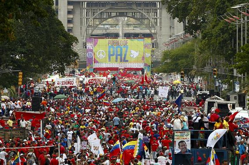 "theladymisskier :      One thing I learned about Venezulea  , whatever the USA media says about it's politics…it is probably the rightwing corporate propaganda's point of view  and I must search wider  for the truth. Why ? because the former president , Chavez snatched the privately owned oil companies and made them property of the state 12 years ago  because they failed to pay taxes.  This was such a bold move against the  1% that the privileged staged a coup and kidnapped Chavez but the guards eventually let the protestors in the palace and the people got their leader back. Under Chavez' leadership, life improved for the masses and finally gave them a voice. When he died last year , the new president Maduro plans on using  the same humanitarian policies bringing up the people…….less kids eating out of the trash, securing shacks built on top of shacks up a mountain so they won't topple from erosion, etc…  The news is polar opposite of US papers I've read. This is the reason I decided to go there myself …so when asked to deeejay …I jumped at the chance 4 years ago. The conservative privledged people complained that Chavez  wanted a 25 year term….and that sounds fascist…but once I saw the  level of poverty , i realized it would take 25 years  atleast to  bring Caracas out of these dreadful living conditions that the corporate greed and corruption  from before the Chavez era had caused.  Everywhere I went I saw support of Chavez except in the exclusive wealthy nite club where I played…who by the way..told me at the end….since you are a Chavista…we will let you live in poverty where you belong and refused to pay me !!! On another note……..when the promotor asks for a FUNK SET  they really mean hardcore minimal TECHNO ! ha ha ! These privledged kids I met where afraid to take me to the ""ghetto"" but I managed to go there and see for myself what they chose to shut out of their lives. ….anyway….when I hear about any social unrest  in Venezuela…. i turn to the U.K.'s Guardian to get a balanced picture about what's going on there today…..and from what I gather it seems the country's majority voted for the new leader, Maduro and his Chavezta policies ( for ALL the people) but  when he won there was a protest against him by the privileged class.  The votes were recounted and it became clear that Maduro did in fact win. A large demonstration of support was held for Maduro (in the picture above)…..however approx 1000 people , some say it's only the rich people , disagreed and  prefer to  oust him . The small group of protestors, much like the oil industry backed coup which temporarily ousted Chavez years ago , are apparently using violence and  seem to prefer a fascist  leader over Maduro. The majority of people and surrounding countries want Maduro.  As I am living in NY…there is little chance to know the full story…but from reading the Guardian…and my own experience… let the majority of voters decide and keep Maduro in office.  this is my 2 cents. Don't believe everything you read…including this…I'm not studying political science or history ..… but keep questioning reality , search to find the facts and make your own opinion before you decide what you'll do. I'm going to the art museum before the Gaultier exhibit closes today. - lady miss Kier"