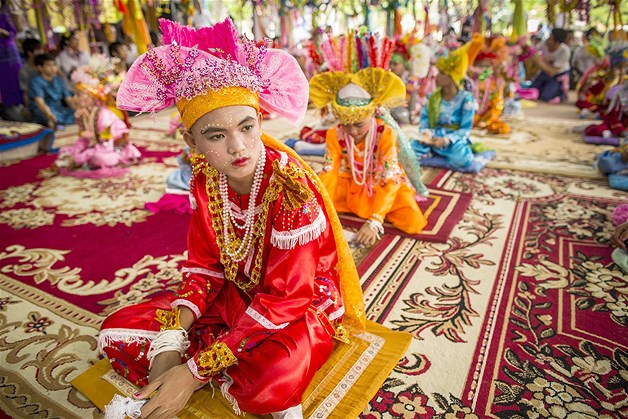 Here is the look  for the boys who will be ordained as Buddhist novices at the Poi Sang Long Festival wait in the prayer hall at Wat Pa Pao in Chiang Mai, Thailand. give me color!!! more color in menswear!!!- lady miss kier