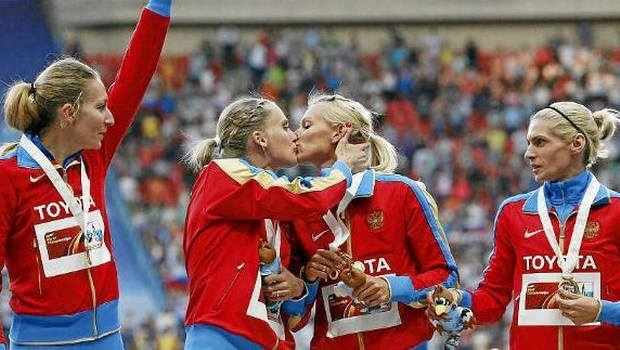 "This is how we do it..yes yes ya'll….Kseniya Ryzhova and Tatyana Firova, two members of Russia's women's 4x400 relay team, defied their nation's ban on ""homosexual propaganda"" when they kissed on the podium during the presentation ceremony for their gold medals at the World Track & Field Championships in Moscow. LET THEM HAVE IT !"