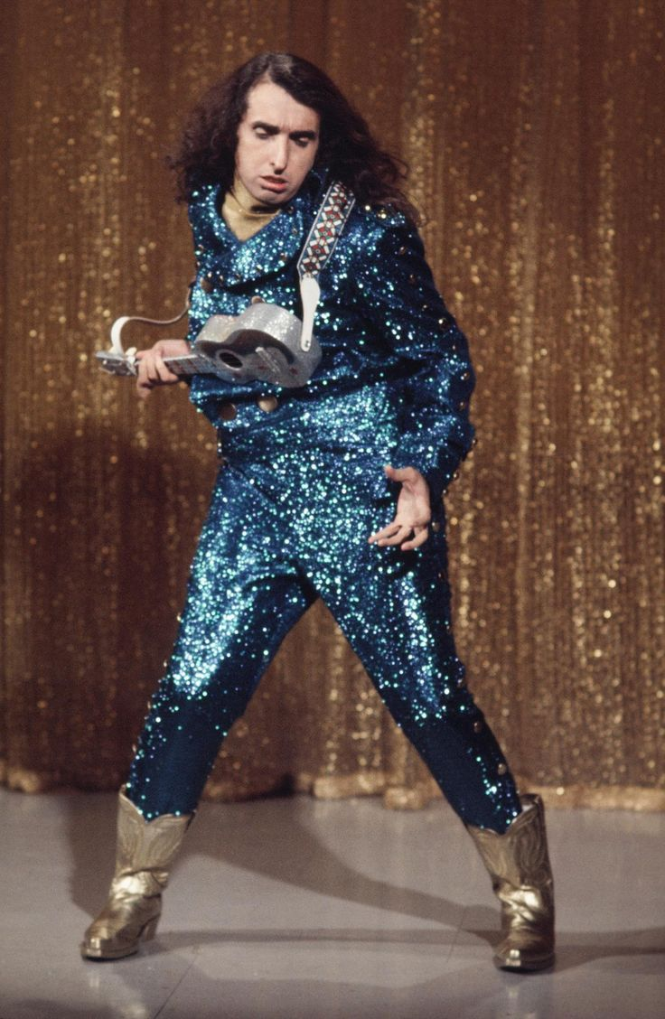 I met him on a greyhound bus…we were both on our way to Atlantic city…..      midcenturymodernfreak :      Tiny Tim in Blue Glitter!   -  Via