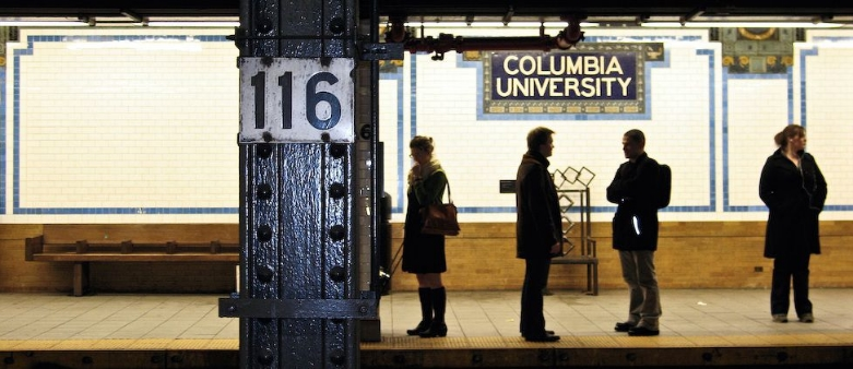 Students wait for a 1 train at 116th Street Station
