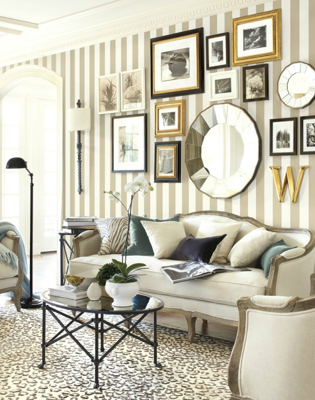 This is a rather fancy display, but it uses a perfect balance of finishes/hues (black/gray, white/silver, gold/brass). The content is cohesive and the pieces are nicely spaced and proportionate to the wall and furniture.