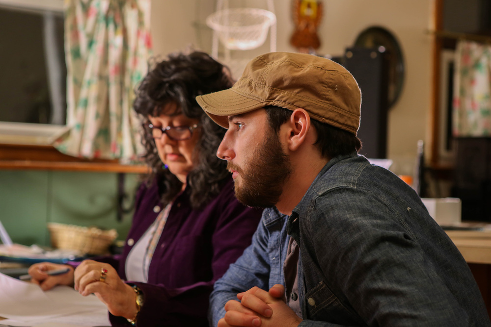Inkwell Director Sam Siske listens to Carla Christina Contreras rehearse her lines on the set of Static.