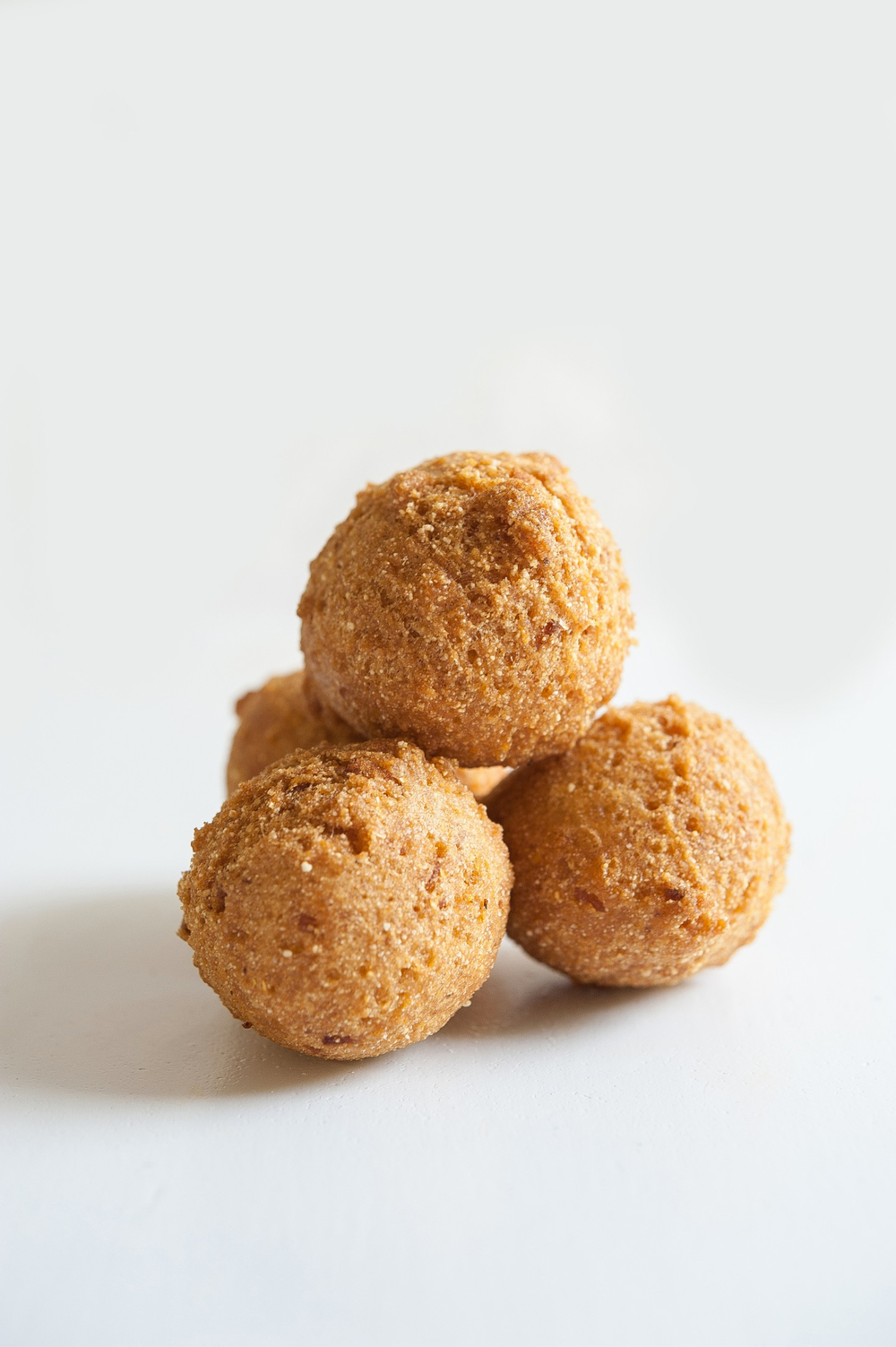 Our hush puppies take on a dessert-like quality with our house dipping sauce (honey, coriander, maple syrup, dash of cayenne)