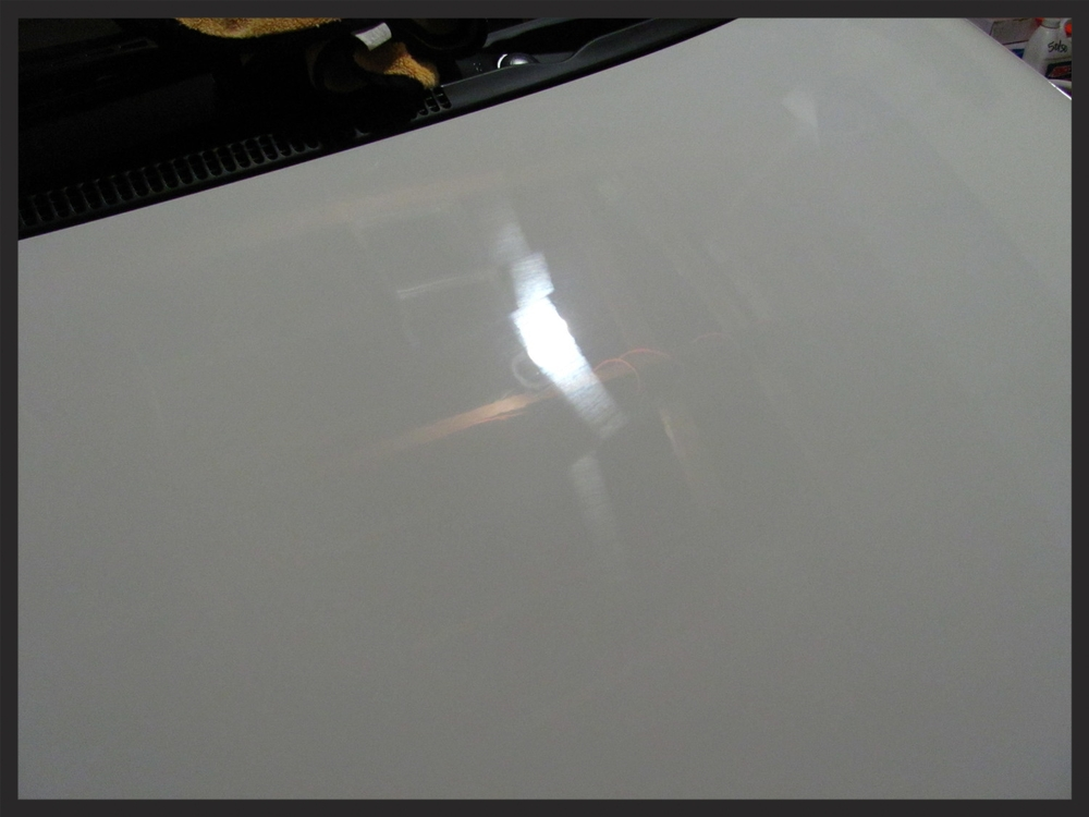 22PLE VX1 Signature Glass Coating just applied. Wait for three to five minutes before using a microfiber towel to remove the product.