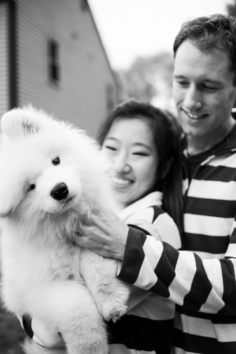 couples engagement portrait with samoyed puppy