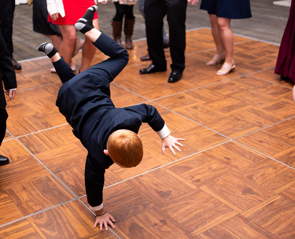 kid break dancing at wedding reception