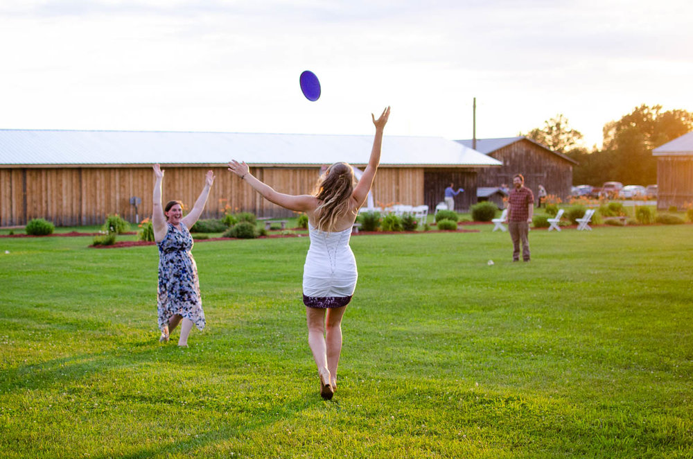 wedding frisbee game during the golden hour