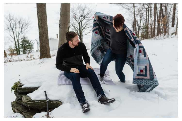 vermont winter engagement portrait session wrapped in a quilt