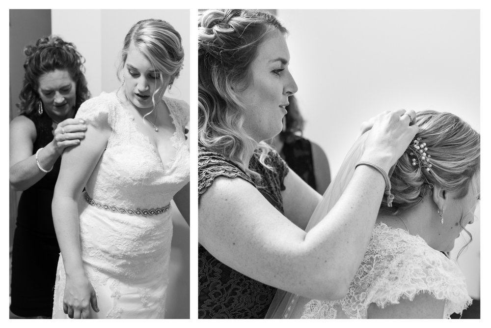 bride getting ready with mother and sister