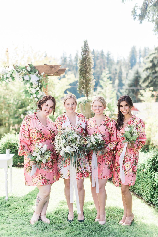 Matching floral bridesmaid robes. Green Gates at flowing lake we