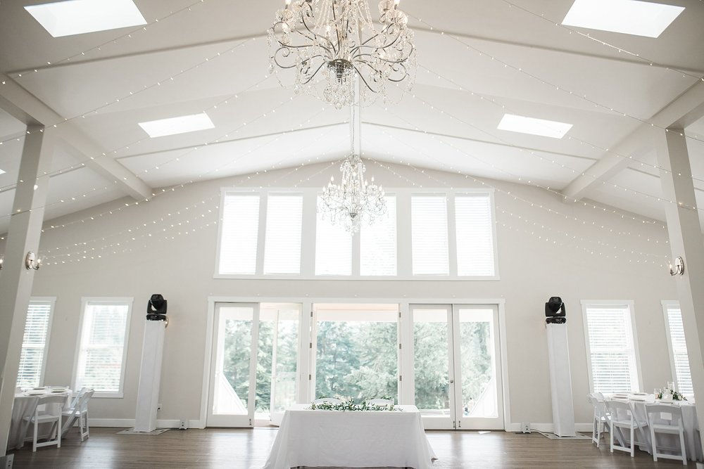 Bright & white reception room with chandeliers. Amazing lighting
