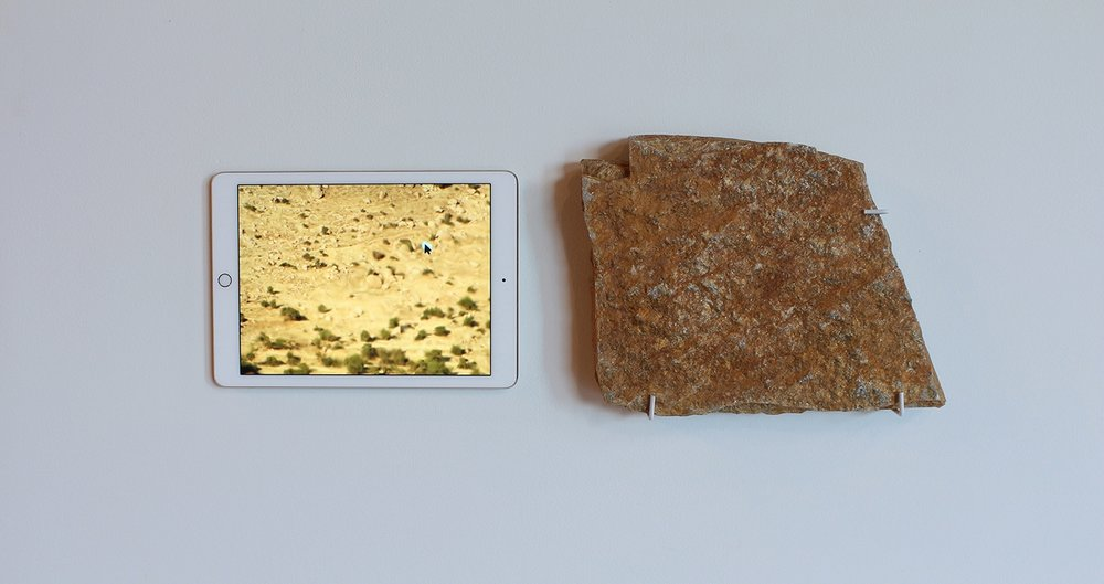 "Barren Fields, rock, iPad, single channel video, 11"" x 24"" x 2.5"", 2017."