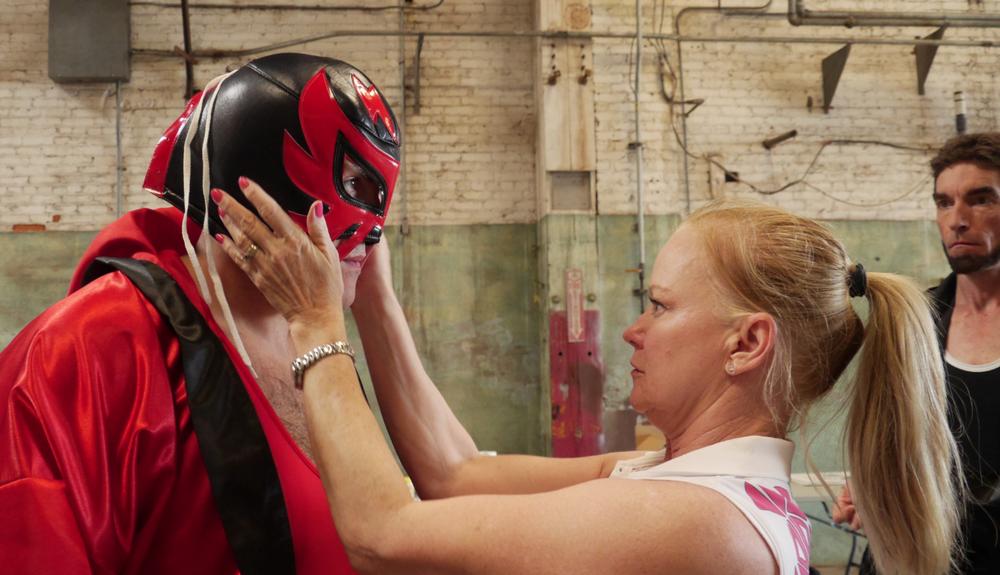 Make Up artist, Jodi Welch, fitting the mask on Hunger.