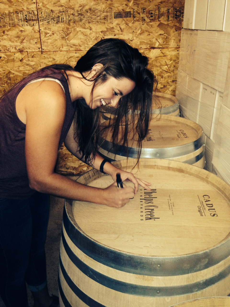 Summer intern, Emily Meagher, marking our new personalized French Oak barrels