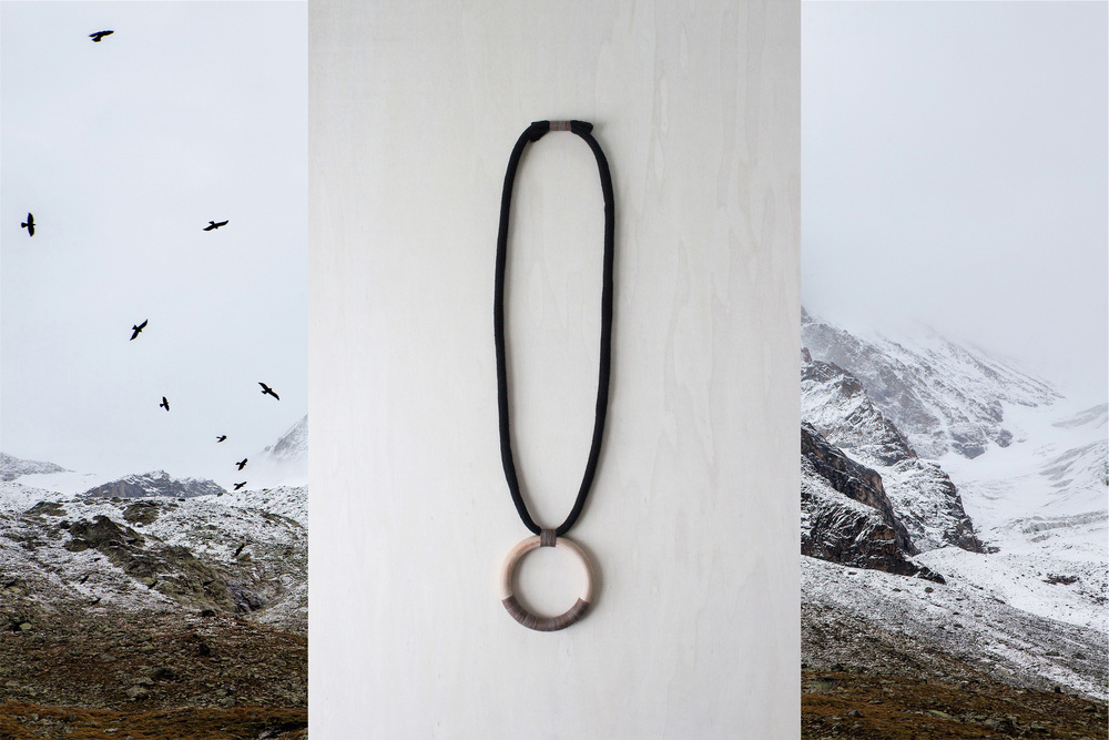 FORESTIERE eclipse necklace mountain scene.jpg