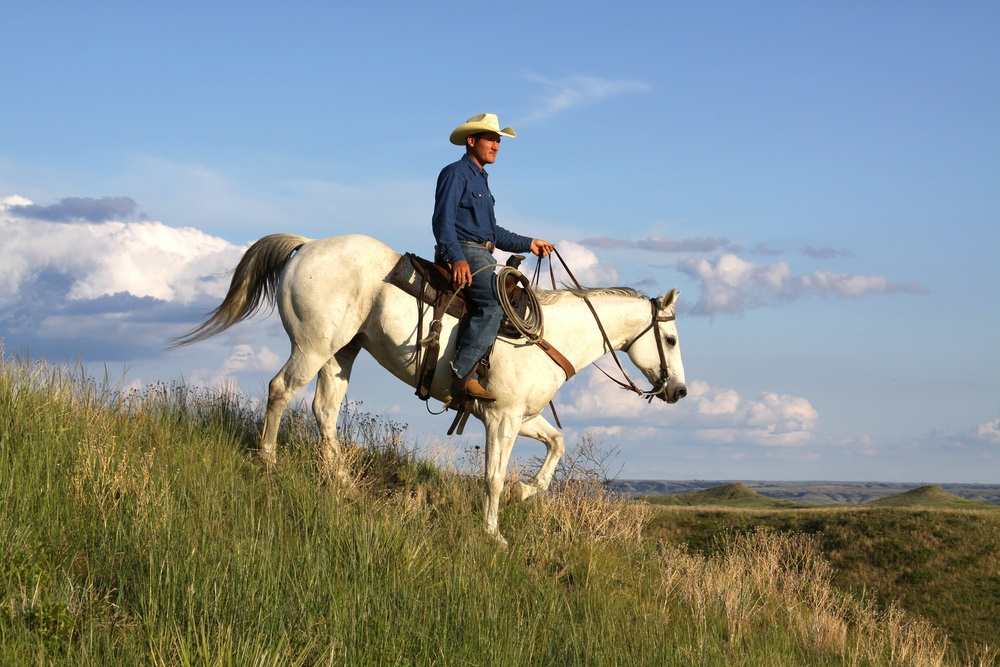 Artist John Lopez horse back on his Uncle Geno's ranch.