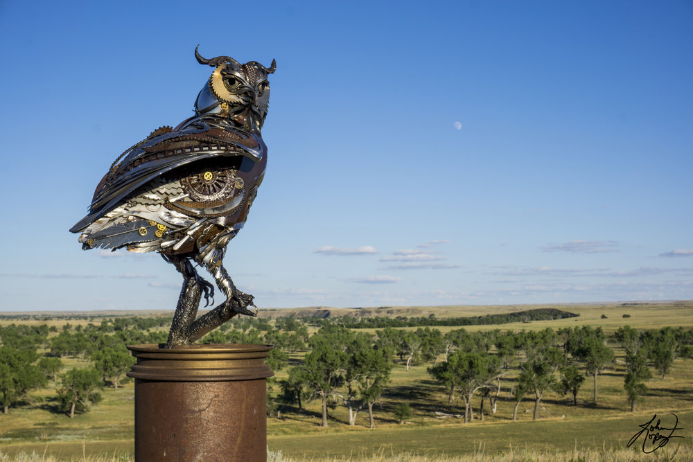 John Lopez Studio - This beautiful bronze sculpture has been attached to a tree since 1968