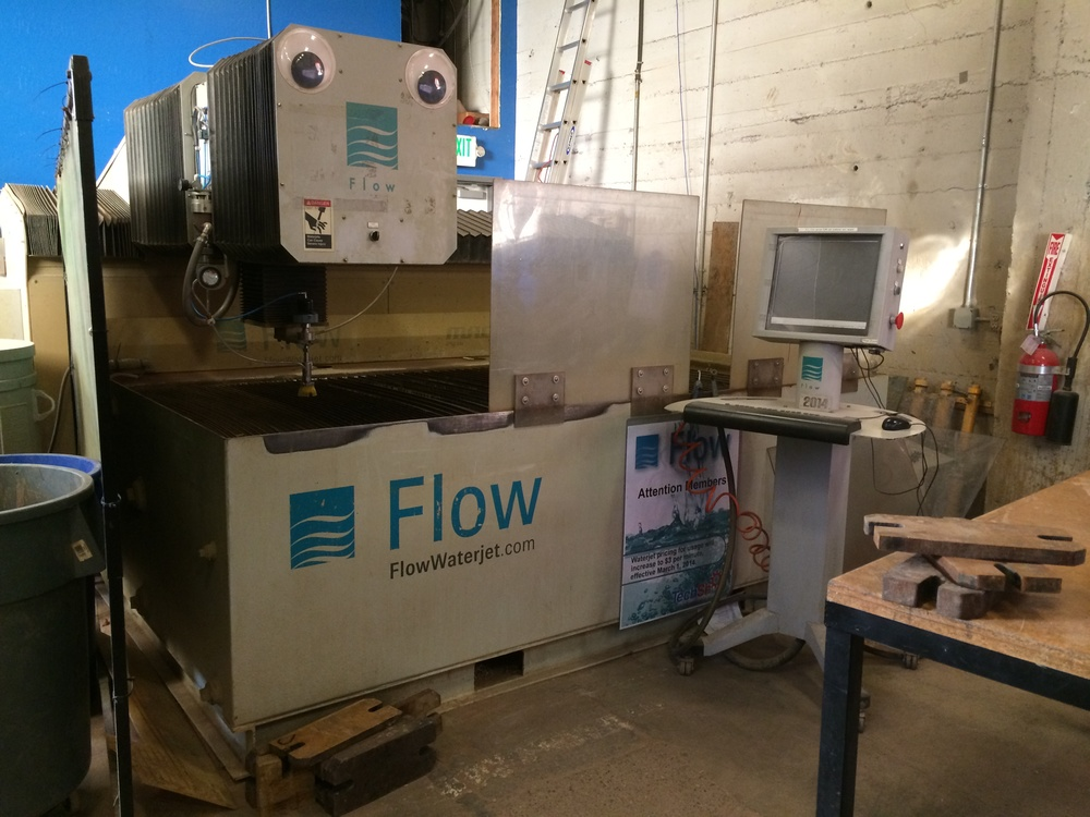 "Flow Waterjet Cutter Mach3 2513b   Use a focused beam of water to cleanly cut through almost any flat material. Specs: - Accuracy 0.0015"" per 3 feet - Build area 8' x 4' - Speed is up to 500ipm - 60K PSI enough to cut through 9"" of steel"
