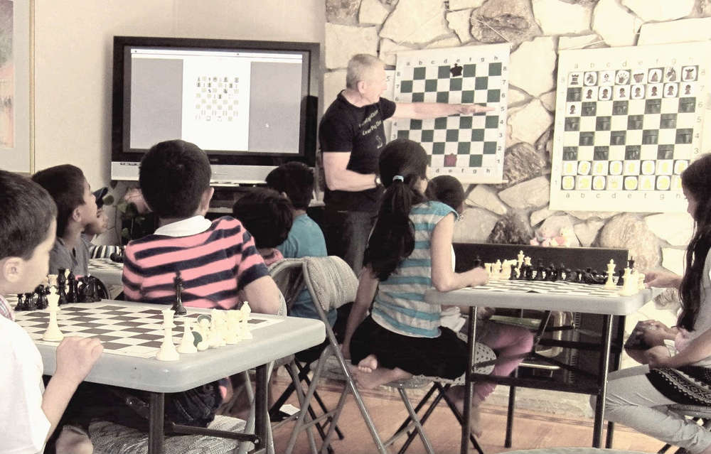 World Master Rated Guy Batraski Teaching an Intermediate Champions Program Class to the 5 years to 12 years old Age Group. Guy has over 20 years teaching Chess & Mathematics to kids looking to improve their chess game, competitively improve their game, or improve their critical & problem solving skills.
