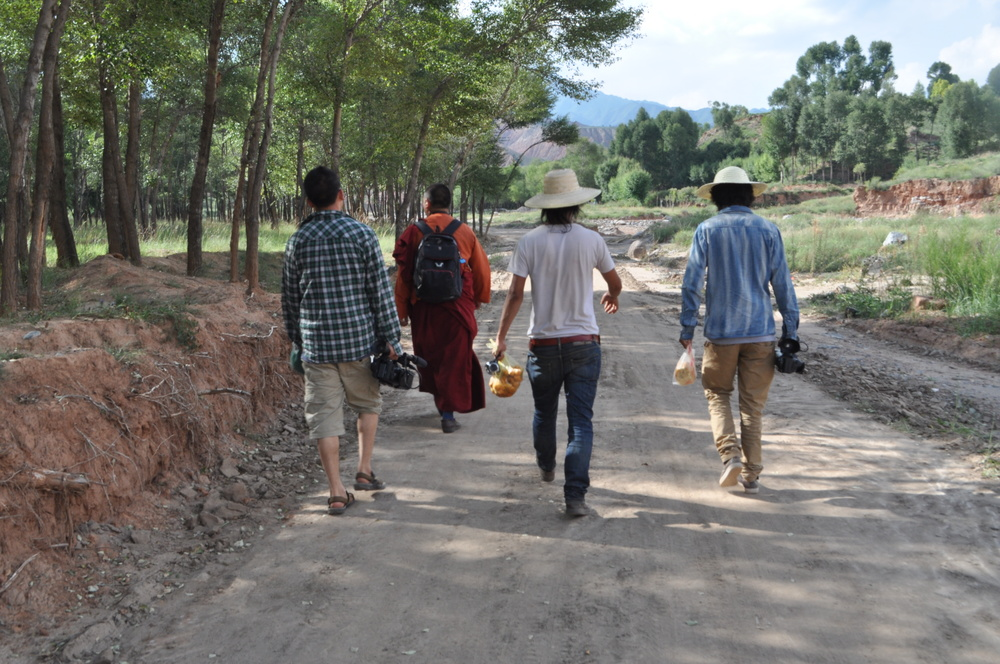 Khashem Gyal, Pade Gyal, Dolma Gyab, and Tenzin Zangbo head off to the field site on foot, after the bridge into town was washed out by heavy rain.