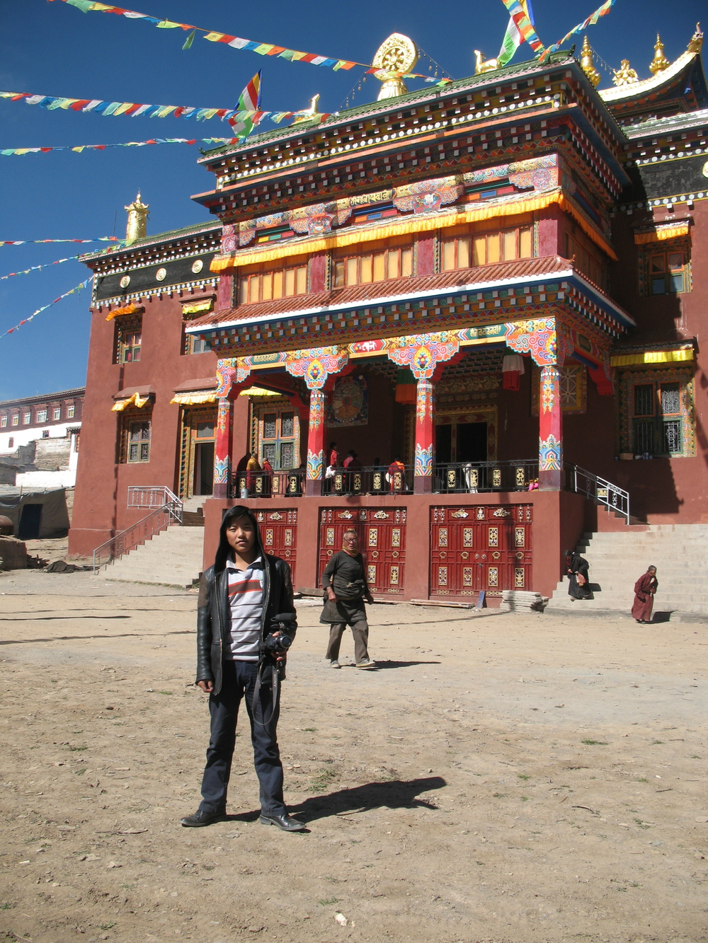 Sonam Drakpa in front of the Assembly Hall at Gemong Monastery