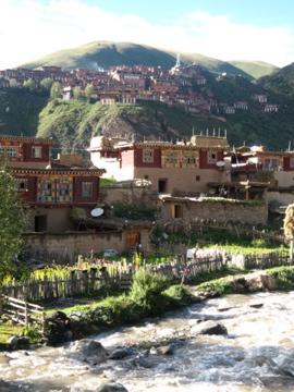 Tibetan homes with Dzongsar Monastery in the background