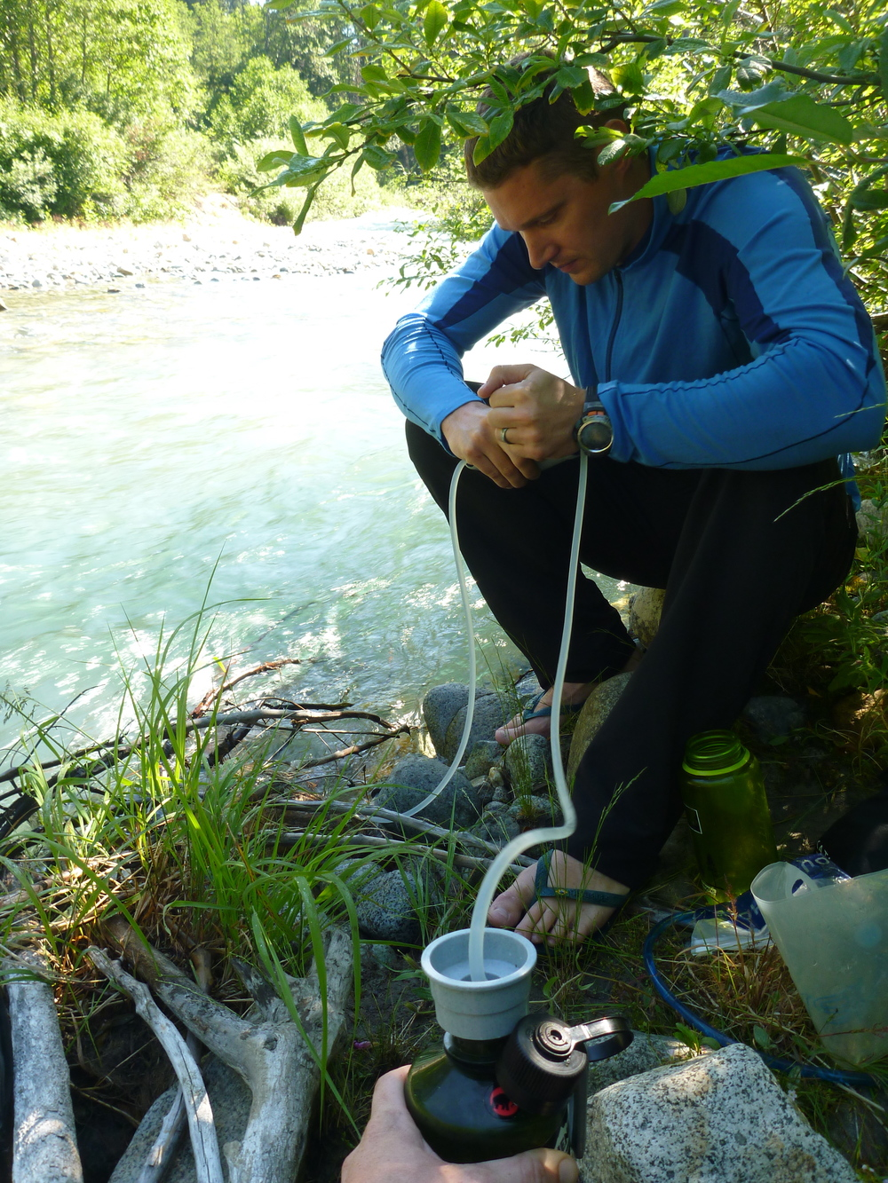 filtering water from the big beaver river, north cascades national park, washington