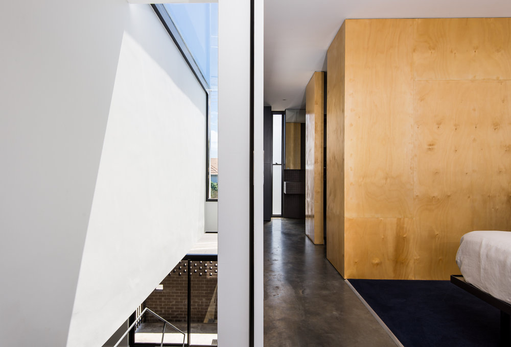 Triangle House by Robeson Architects - Plywood Wardrobe