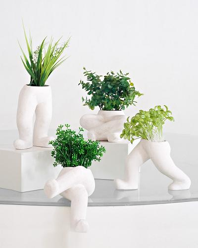 Co-Creative Studio Levi Natural Stone All-Weather Fun Planters.jpg
