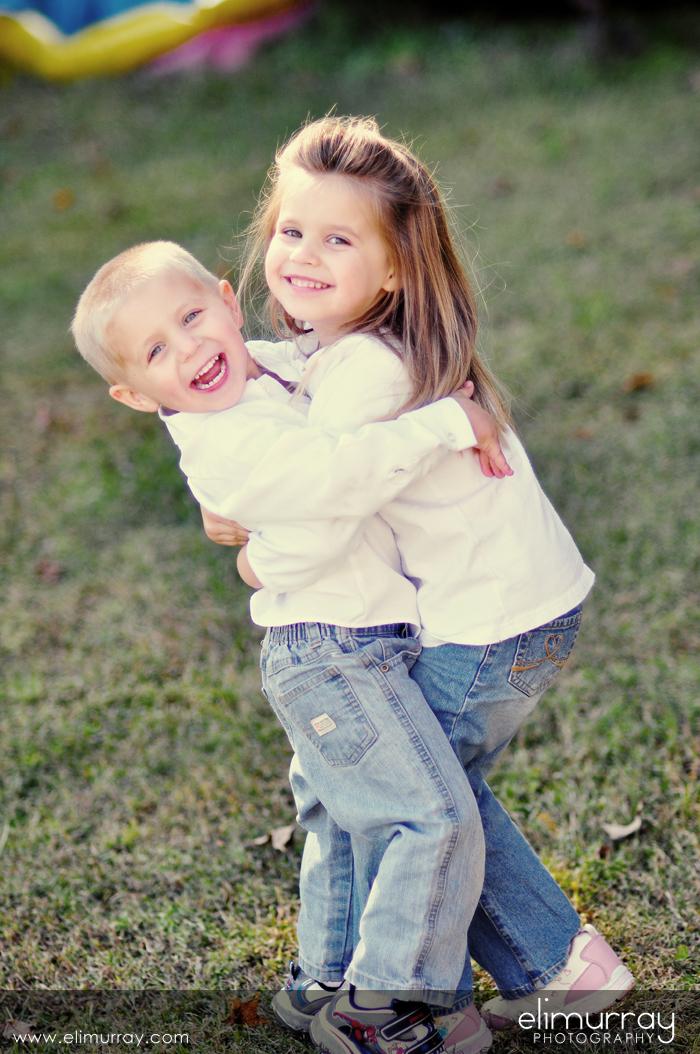 Happy Siblings Hugging