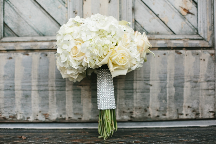 Bouquet standing against wood door