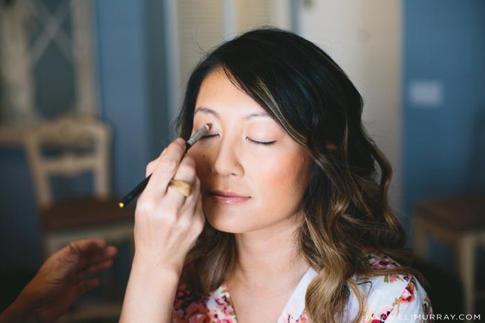 Bride getting makeup done before wedding in Portofino Hotel