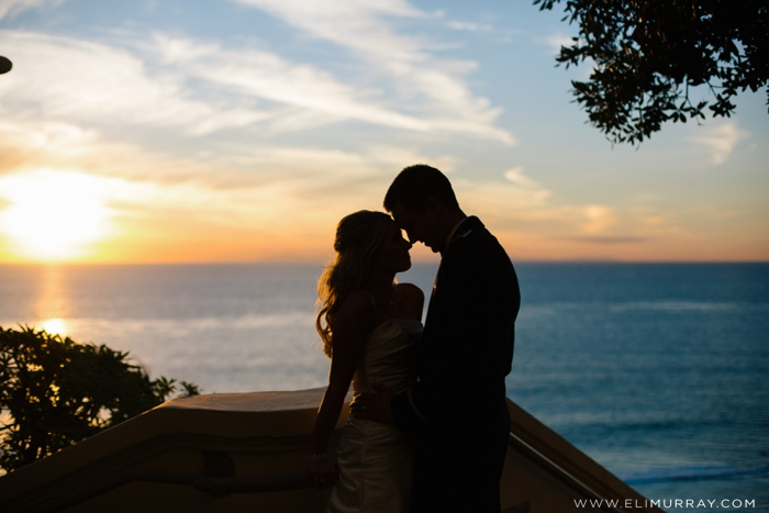 sunset photo of bride and groom at the ritz-carlton