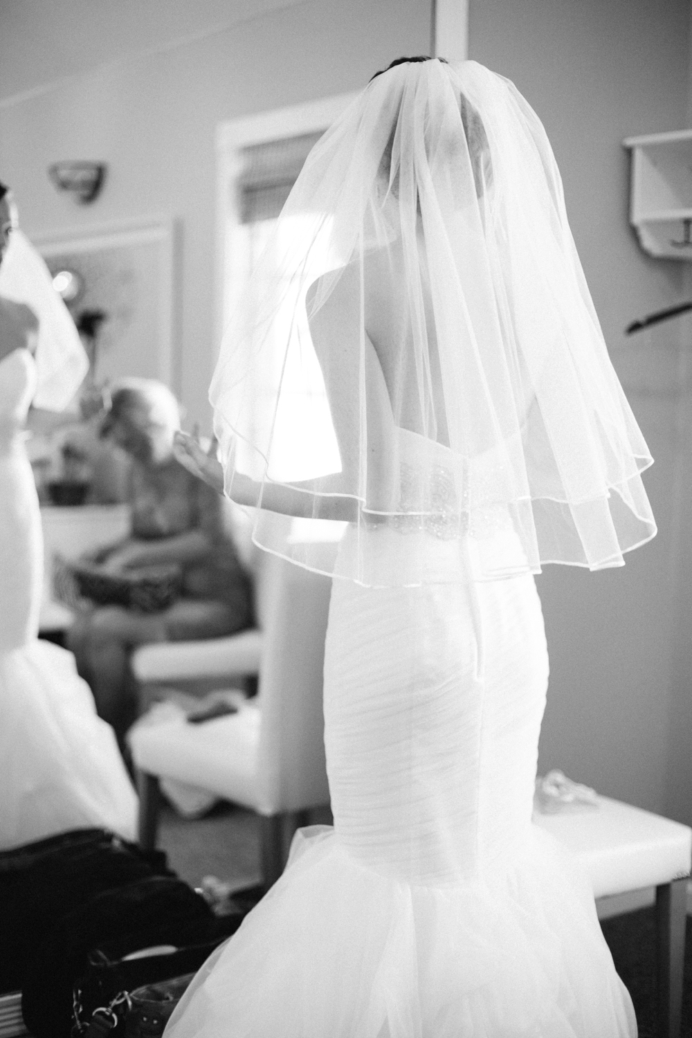 bride with veil in dressing room
