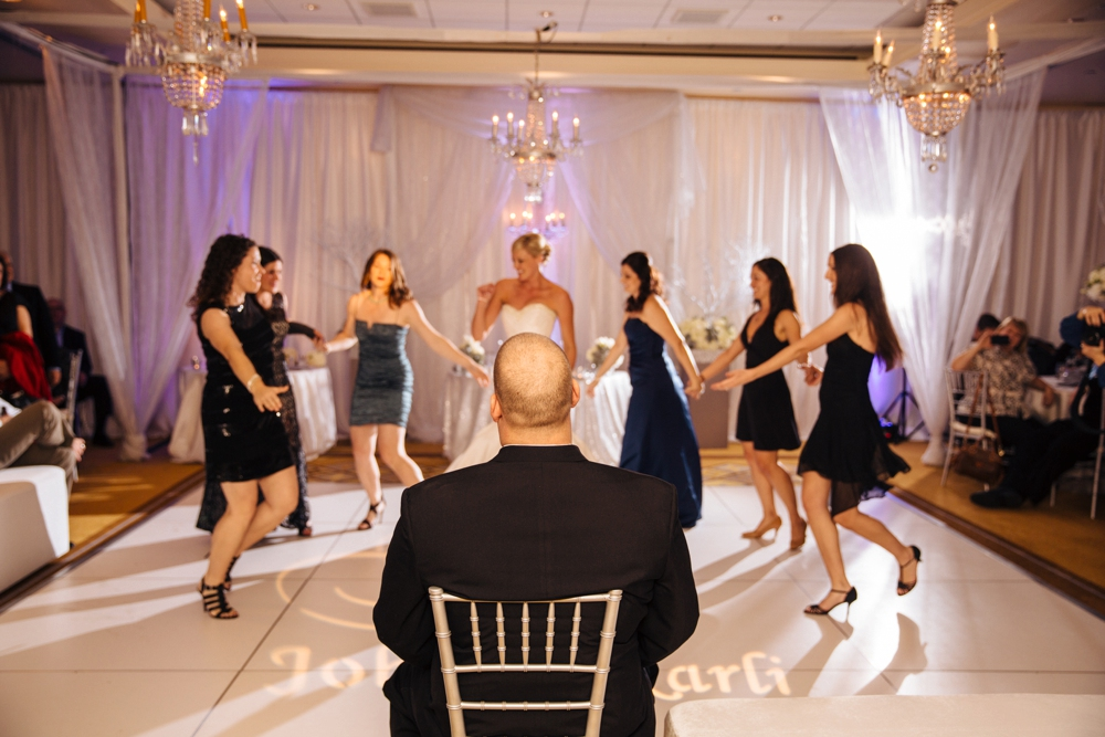 Bridemaids dancing for the groom