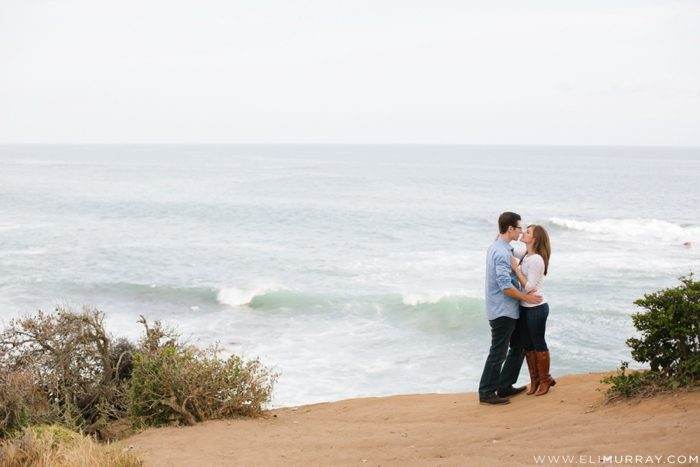 Couple on cliff in Laguna Beach