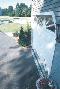 A trench drain installed at a Driveway in Darien, CT is a good example of an engineered drainage solution.