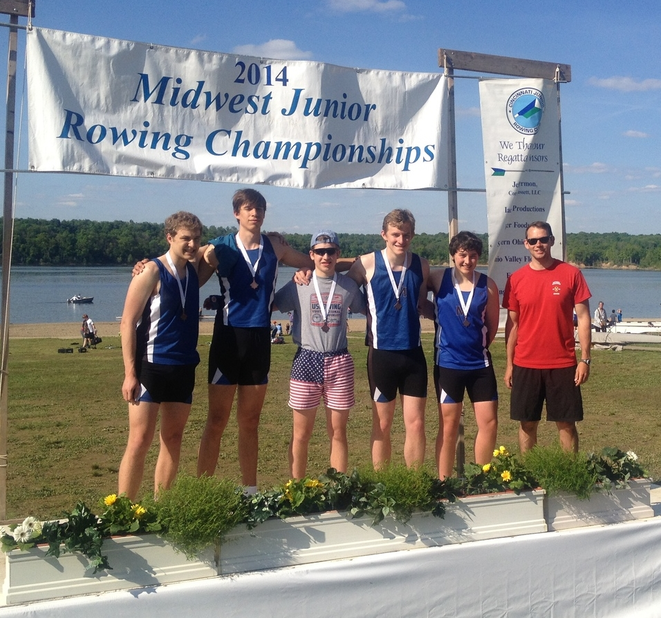 The Mens Second Varsity 4+ on the medal stand