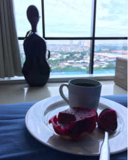 A quiet 5:30am breakfast with Vincenzo. Red dragon fruit scooped right out of its shell and coffee while watching Jakarta slowly wake up. Jet lag has its benefits ☕� 😴