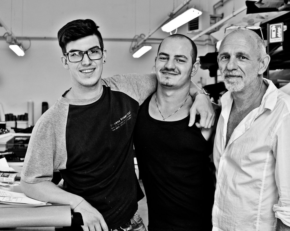- A contagious sense of camaraderie resonates in the factory, even with the wide age range of the employees. They can be found on Fridays enjoying their lunches in the local park, or sharing a laugh with us over an espresso.Crafting our bags is definitely a team effort, and despite the heavy demands of some of their larger clients, they dedicate the same passion and energy to all clients, both large and small.