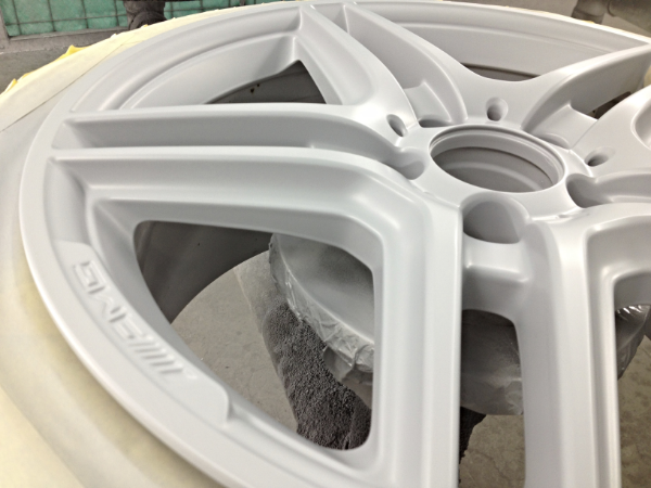 Wheel is first painted to match vehicle's body color