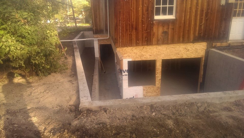 Digging Out Basement Part - 30: We Added A Walk-out Basement To This Existing Structure. A Retaining Wall  Was