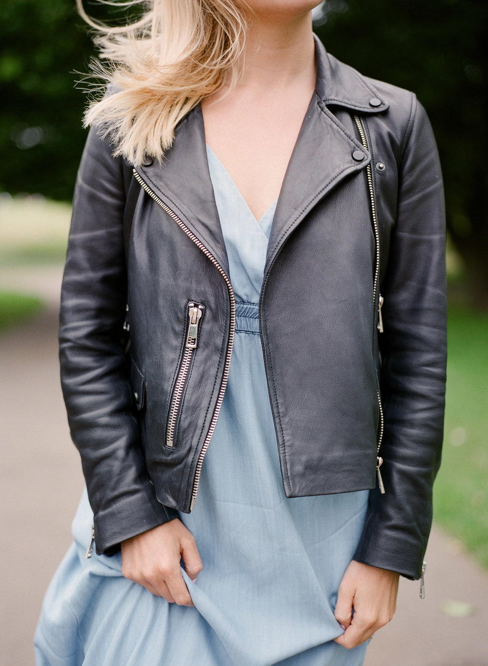 leather jacket and blue dress in london fashion by imogen xiana